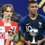 France's forward Kylian Mbappe (R) poses with the FIFA Young Player award beside Croatia's midfielder Luka Modric holding the adidas Golden Ball prize